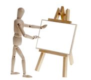 Wooden man paints a picture Stock Photography