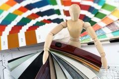Wooden man, palette, furnishing materials, plan Stock Photo