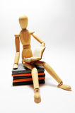 Wooden man reading Royalty Free Stock Photo