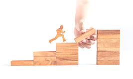 Wooden man run across business cliff. Wooden man run across cliff, business challenge Royalty Free Stock Image
