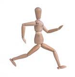 Wooden man running Stock Image