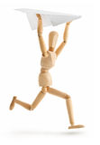 Wooden man running with paper airplane royalty free stock images