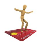 Wooden man stands on the credit card surfer pose Royalty Free Stock Image