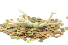 Wooden man swimming in money Stock Photography