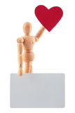 Wooden man toy statue with heart and blank card for text studio Stock Photography