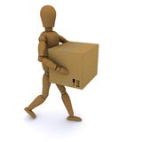 The wooden man walks with a closed cardboard box Royalty Free Stock Photography