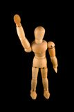 Wooden Man Waving. A wooden man waving Stock Images
