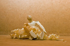 Wooden man in wood shavings. Stock Photos
