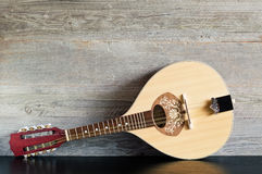 Free Wooden Mandolin On A Black Table Stock Photos - 89659763