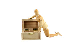 Wooden manikin opening treasure chest Stock Images