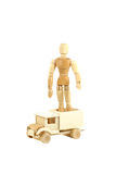 Wooden manikin standing on truck Royalty Free Stock Photo