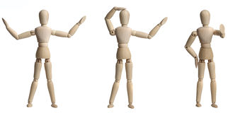 Wooden Mannequin. Isolated on a white backgorund royalty free stock photo