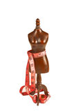Wooden mannequin. With measuring tape of the tailor Royalty Free Stock Image