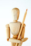 Wooden mannequin. Isolated on white background with a pencil stock photo