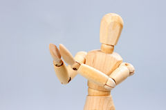 Wooden mannequin applauds Stock Photography