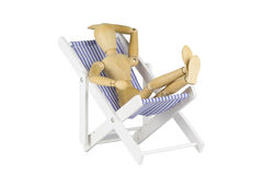 Wooden mannequin on a beach chair Stock Image