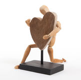 Wooden mannequin with a big heart Royalty Free Stock Photography