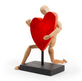 Wooden mannequin with a big heart Royalty Free Stock Image