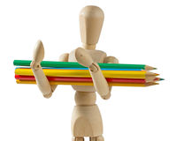 Wooden Mannequin Carrying Colored Pencils Royalty Free Stock Images