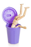 Wooden mannequin doll upside down in purple dustbin, isolated Stock Photos