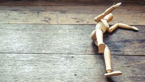 Wooden mannequin falling down. Fall concept. Business. Life. Failure idea. Background stock photography