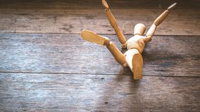Wooden mannequin falling down. Fall concept. Business. Life. Failure idea background stock photo
