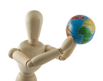 Wooden mannequin with globe. Wooden dummy with a earth globe in hands on white background Royalty Free Stock Photography
