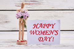 Wooden mannequin and greeting card. How to congratulate woman stock photo