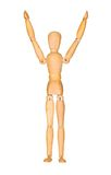 Wooden mannequin with hands up in the air Stock Image