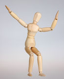 Wooden mannequin happy. Wooden mannequin is happy,isolated stock photography