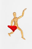 Wooden mannequin with heart Stock Image