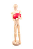 Wooden mannequin holding a easter egg. Standing mannequin holding an Easter red egg stock images