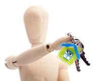 Wooden mannequin holding keys Royalty Free Stock Photos