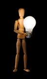 Wooden mannequin holding light bulb Stock Photos