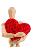 Wooden mannequin holding red heart, on white Royalty Free Stock Photography