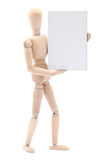Wooden mannequin holding sign. A wooden mannequin holding a blank sign stock image