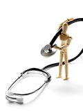 Wooden mannequin holding a stethoscope Royalty Free Stock Image