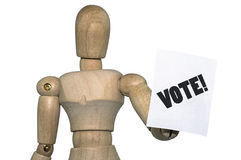 Wooden mannequin holding a VOTE! flyer Stock Photo