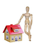 Wooden mannequin and a house Royalty Free Stock Image