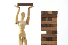Wooden mannequin human model scale playing game Royalty Free Stock Images