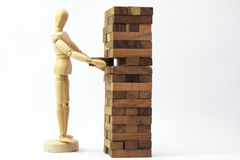 Wooden mannequin human model scale playing game Royalty Free Stock Photography