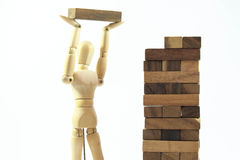 Wooden mannequin human model scale playing game Royalty Free Stock Image