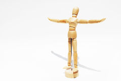 Wooden mannequin human scale model isolated. Wooden mannequin human scale model. Rise hand up. Act like to fly royalty free stock photos