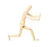 Wooden mannequin, isolated on white. Wooden mannequin pushing something isolated on white background stock photo