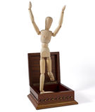 Wooden Mannequin Jumping Out of a Box Royalty Free Stock Photo