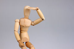 Wooden mannequin looking stock image