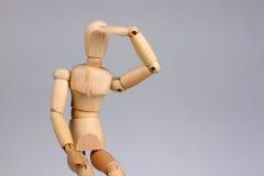 Wooden mannequin looking. Wooden mannequin dummy looking far away stock image