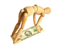 Wooden mannequin with money Stock Photos