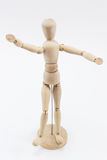 A wooden mannequin with open arms. A wooden mannequin with open arms, waiting to hug somebody, on a white surface stock photo
