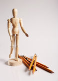 Wooden mannequin for painting with pencils on a Royalty Free Stock Images